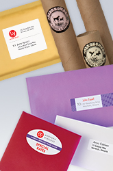 A padded envelope with a white rectangular shipping label, a red envelope with an oval white label, mailing tubes with round colourful branded labels